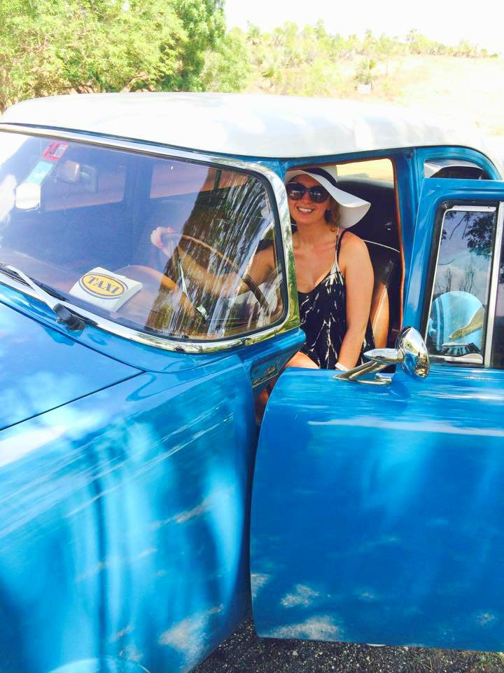 blue classic American car in Cuba