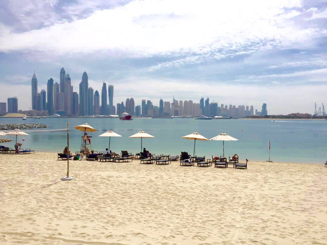 Beach view of Dubai marina skyline from Oceana beach on the Palm