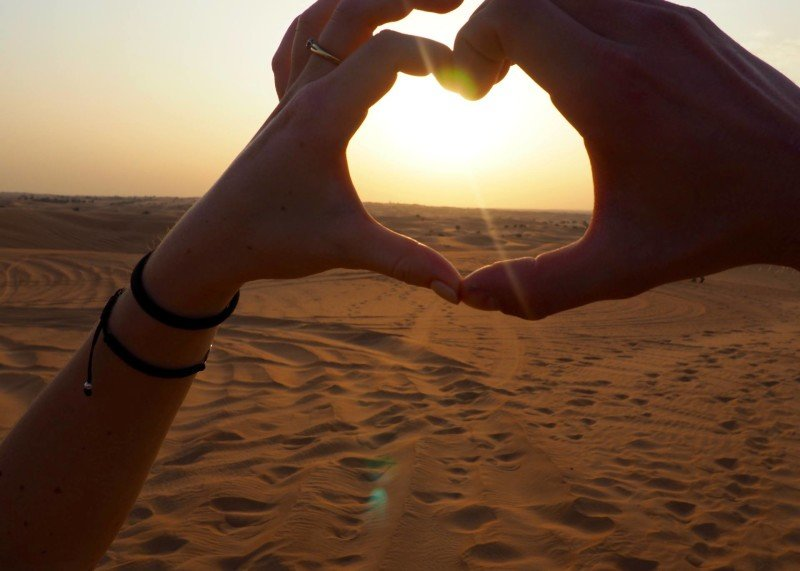 hand heart by couple